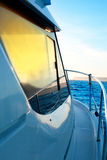 Blue golden sunrise sailing on boat side Stock Photo