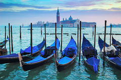 Blue gondolas in the night in Venice, Italy. Royalty Free Stock Photos