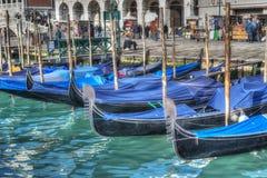 Blue gondolas by San Marco shore in Venice Stock Photos
