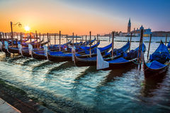 Blue gondolas at sunrise in Venice Royalty Free Stock Images
