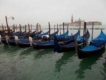 Blue Gondolas in Venice Italy in a quiet place. royalty free stock photography