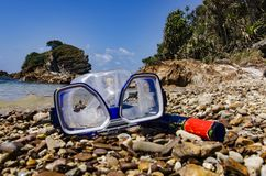 Blue googles or mask for snorkeling or swimming on the beach at sunny day. Selective focus shot Royalty Free Stock Photos
