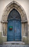 Blue Gothic wooden door. Fragment an ancient build with blue Gothic wooden door Stock Images