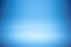 Blue gradient abstract studio wall for backdrop design product or text over. Blue gradient abstract studio wall for backdrop design for product or text over Royalty Free Stock Image