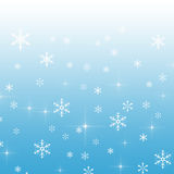 Blue gradient background with snowflakes Stock Photo