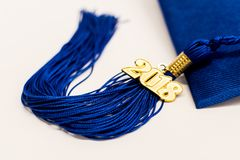Graduation 2018 Cap and Tassel. A blue graduation cap and tassel with a 2018 pendant on a white background stock photography