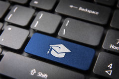 Blue graduation keyboard key, Education background Royalty Free Stock Photos