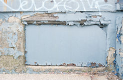 Blue Graffiti Frame. Blue painted area with peeling paint and graffiti frame Stock Image