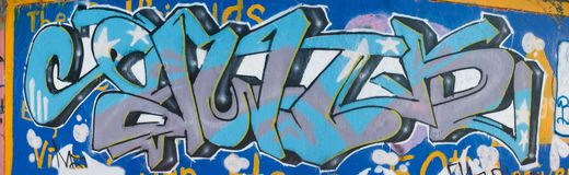 Blue graffiti mural. Stylish graffiti letters in blue shades Stock Image