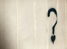 Heart Related Issues?. A blue graffiti in the shape of a question mark with a small heart instead of the dot, on a white metal wall with creases pattern Royalty Free Stock Photo