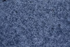 Blue Granite rock closeup background, stone texture, cracked surface stock image