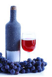 Blue grape cluster and red wine Royalty Free Stock Image