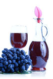 Blue grape cluster and red wine Stock Photos