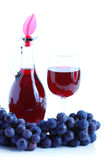 Blue grape cluster and red wine Stock Photography