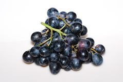 Blue grapes from above Royalty Free Stock Photography