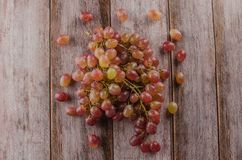 Blue grapes with green leaf healthy eating, isolated. On wood background stock photos