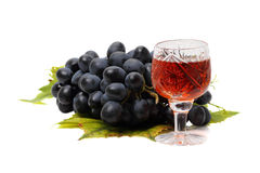 Blue grapes and red wine Royalty Free Stock Image