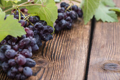 Blue Grapes (on wooden background) Stock Photo