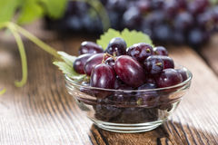 Blue Grapes (on wooden background) Stock Images
