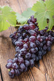Blue Grapes (on wooden background) Royalty Free Stock Image