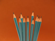 Blue Graphite Pencils. On an orange-brown background Stock Photography