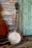 Blue Grass Band Instruments. In old rustic cabin setting Royalty Free Stock Photography