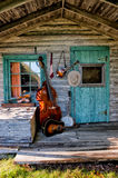 Blue Grass Band Instruments. In old rustic cabin setting Royalty Free Stock Photo