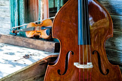 Blue Grass Band Instruments. In old rustic cabin setting Stock Photography