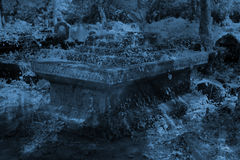 Blue Grave. A dangerous background for halloween of a mysterious grave in a cemetery, in moonlight Royalty Free Stock Photos