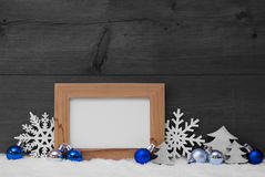 Blue Gray Christmas Decoration, Snow, Copy Space. Blue Christmas Decoration On White Snow. Christmas Tree Balls, Snowflake, Christmas Tree. Picture Frame With Royalty Free Stock Image