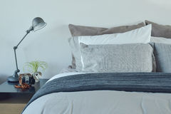 Blue and gray color scheme bedding with industrial style table lamp Stock Image
