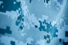 Blue gray colour digital pattern camouflage of navy uniform royalty free stock images
