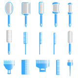 Blue gray hair combs and hair brushes Royalty Free Stock Images
