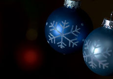Blue and gray ornaments against dark background Royalty Free Stock Image