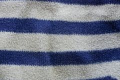 Blue gray striped fabric texture of a piece of wool on clothes royalty free stock photography