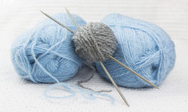 Blue and gray wool yarn ball Stock Image
