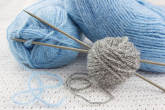 Blue and gray yarns for knitting Stock Images
