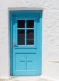 Blue greek church door Stock Photos
