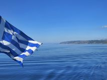 Blue Greek flag. Athos peninsula. Stock Photos