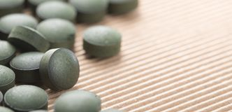 Blue Green Algae. Detail of Artisanal Spirulina Tablets over nat Stock Image