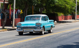Blue green american classic car with white roof drive on the street trough Varadero Cuba Royalty Free Stock Image