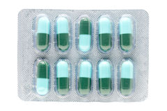 Blue green antibiotic pills gelatin capsule in blister pack Stock Photos