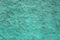 Blue green aquamarine granular wall surface with deep relief and shadows. rough texture. A blue green aquamarine granular wall surface with deep relief and stock photography