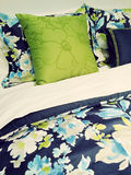 Blue and green bed linen with floral design Stock Photos