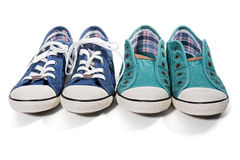 Blue and green canvas sneakers Stock Photos