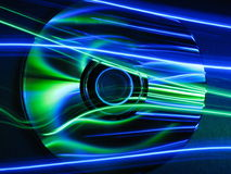 Blue and Green CD. CD with blue and green light streaming across it Royalty Free Stock Photos