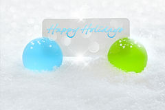 Blue & Green Christmas Ornament - Holiday Text. Elegant Blue and Green Christmas Ornament With Happy Holiday Text Greeting On White Card Nestled In White Snow Royalty Free Stock Image