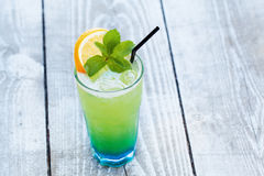 Blue green cocktail with orange and mint Royalty Free Stock Image