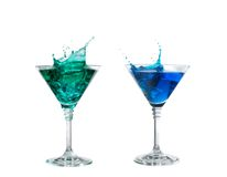 Blue and green cocktail with splashes on white Royalty Free Stock Photography