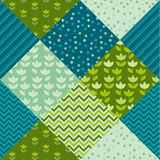 Blue and green color tulip flower and geometry motif patchwork. Stock Photos